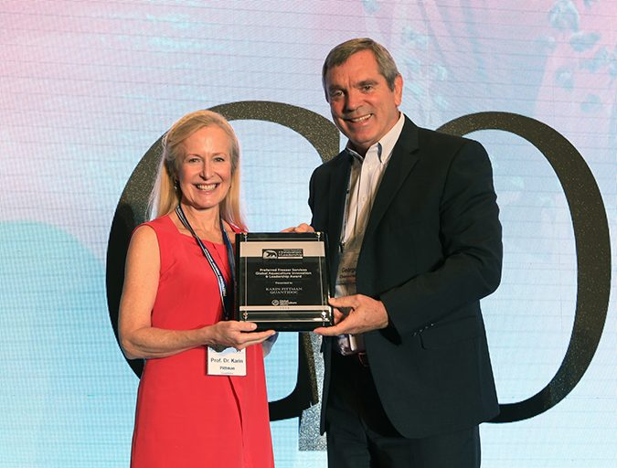 University of Bergen Professor Karin Pittman accepts the Global Aquaculture Innovation & Leadership Award from George Chamberlain, president of the Global Aquaculture Alliance.